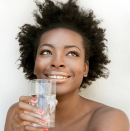 Woman-drinking-a-glass-of-water-8513041